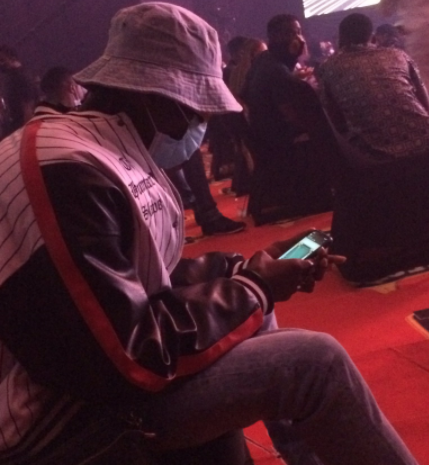 Blaqbonez reacts after he was captured playing iMessage games at the Headies