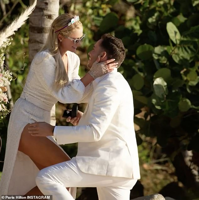 Paris Hilton is engaged for a fourth time as boyfriend of one-year Carter Reum proposes to her with huge emerald cut diamond ring?(Photos/Video)