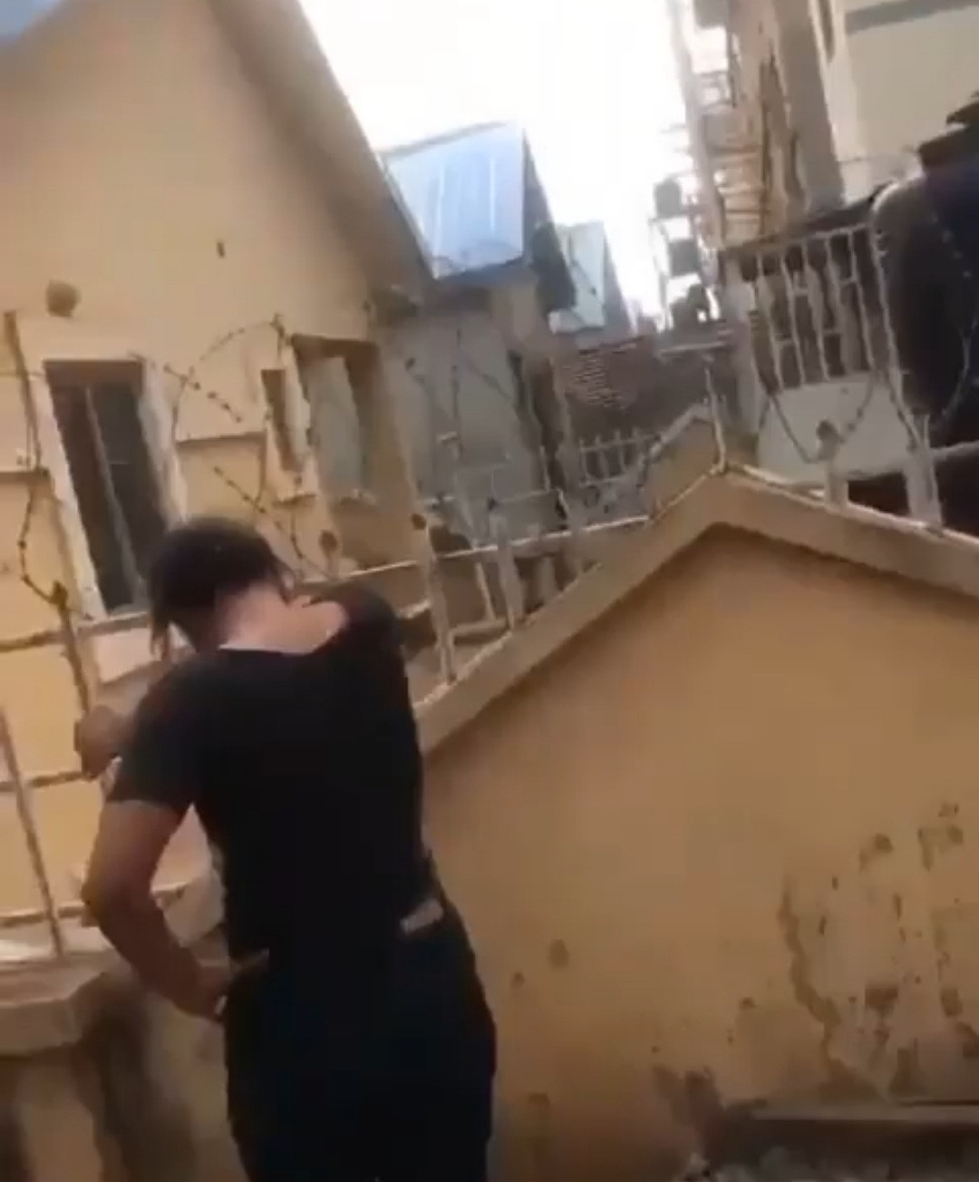 Drama as Abuja side chic allegedly heats oil and pours it on her married lover (video)